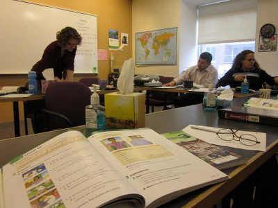 Harvard University Bridge Program students go over a workbook exercise in Jennifer Goulart's ESOL class. (Photo by Sarah Butrymowicz)