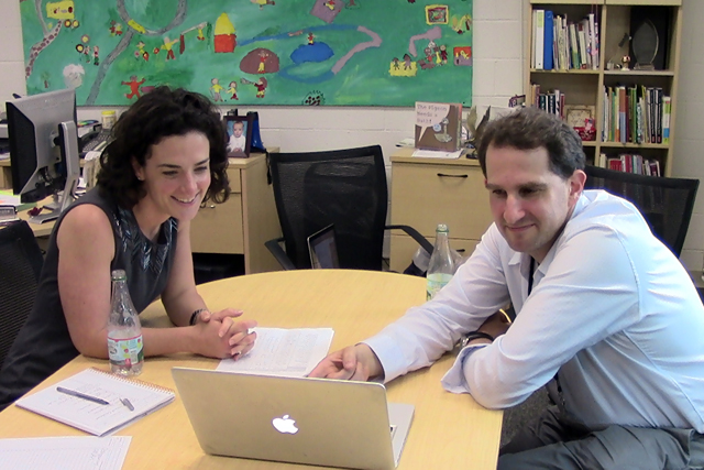 Springhurst's principal, Julie Drake, meets with math specialist Josh Rosen in her office to review students' recent math performance. (Photo: Pat Wingert)