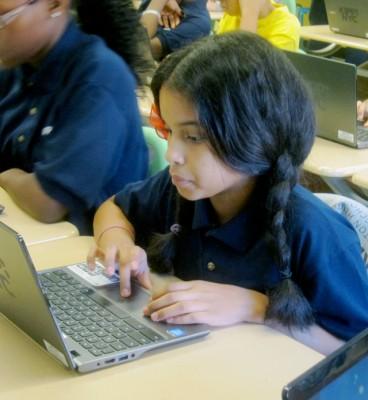 Sherlisbeth Alvarado tries to complete Khan Academy's math drills in her sixth-grade computation class at KIPP Washington Heights Middle School (Gail Robinson)