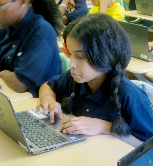 Sherlisbeth Alvarado tries to complete Khan Academy's math drills in her sixth-grade computation class at KIPP Washington Heights Middle School (Gail Robinson)