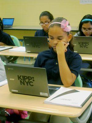 Sixth-graders Lizbeth Hernandez, Amanda Torres and Stephanie Patino work on computers during their computation class as KIPP Washington Heights Middle School. (Gail Robinson)