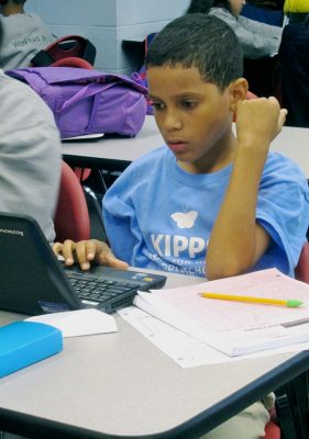 Nelson Trifolio, a fifth-grader at KIPP Washington Heights Middle School, studies one of the Khan Academy drills on his playlist of math skills. (Gail Robinson)