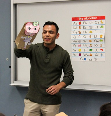 """A student in an undergraduate teacher preparation class at California State University Northridge presents a reading lesson to the class.The school 's undergraduate education classes were rated highly in several categories, but the program overall received a low score."" (Photo by Jackie Mader)"