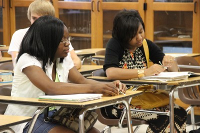 Students at The Mississippi School for Mathematics and Science take notes during a science class. Students at the state-funded residential high school have access to laboratory equipment that rivals most colleges. (Photo by Jackie Mader)