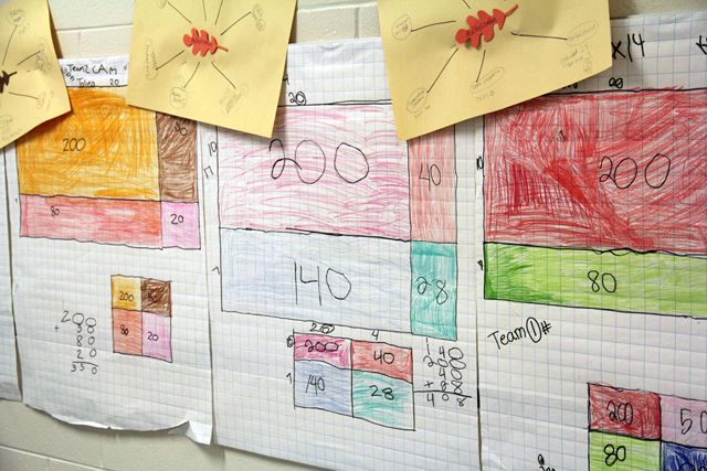 "Student work in the hallway of a Mississippi elementary school shows the ""partial product"" method of solving a multiplication problem. The new Common Core standards emphasize multiple ways of solving problems. (Photo: Jackie Mader)"