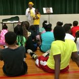 Lynn Gilmore reads to Freedom School students in McComb.