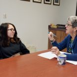 Gautier High School student Cecilia Cox talks with Early Beginnings program director Connie Jo Williams about the goals she set during her first semester. (Photo: Kayleigh Skinner)