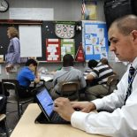 "Raymond Park Intermediate Academy Principal Ryan Russell sits in on the fifth-grade classroom of Jen Hess for a three- to five-minute ""walk through"" evaluation of her class."