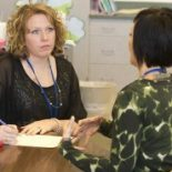 Consulting Teacher Jennifer Hudson Roberts of Anderson Community Schools meets with teacher Shalimar Foster.