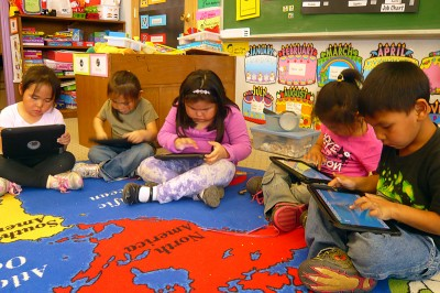 Kindergartners in Gambell play on iPads at the end of the day. (Photo by Sarah Garland)