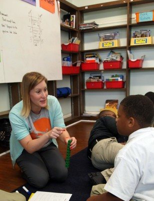 Greta Anderson works with 5th grade students at New Orleans' Dibert elementary school. Anderson has embraced the Common Core, doing considerable online research on her own. (Photo: FirstLine schools)