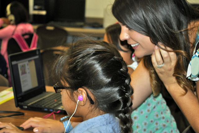 Leah Byrne, a fourth-grade teacher at Louis VanderMolen Fundamental Elementary in Riverside County, works with student Isabella Garcia during a reading exercise. Students at the Corona-Norco Unified school use a program that delivers challenging fiction and non-fiction stories to students regardless of their reading level. Students advance by correctly answering quizzes after each story.