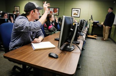 Junior Nick Mills of McKinney is going to the University of North Texas because of the Emerald Eagle Scholar program, an affordable education plan for lower-income families. Here he writes notes during his psychology  class on campus, Monday, January 27, 2014. (Tom Fox/The Dallas Morning News)