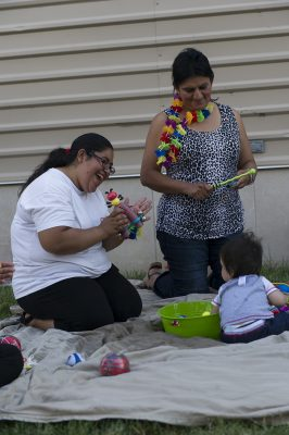 Laura Barrios (left), leading activities for babies during an educational playgroup with Lorenza Pascual. (Kim Palmer / Hechinger Report)