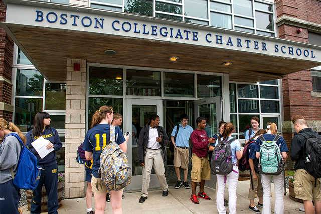Students exit school through the front entrance after classes at the Boston Collegiate Charter Middle & High School campus on June 16, 2014 in Dorchester, Massachusetts. (Photo: Ann Hermes/The Christian Science Monit​or) No reproduction