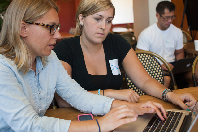 iZone mentor Diedre Downing, a math teacher at NYC iSchool in Manhattan, walks Blended Learning Institute participant Juliana Matherson through Google' Autocrat application on July 18, 2014 in Manhattan. Autocrat lets teachers give custom feedback to students after an online assignment. The New York City Department of Education's Blended Learning Institute is a two-year training program taught by current classroom teachers on how to use the part digital, part traditional classroom style. (Photo: Alexandria Neason)