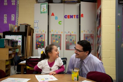 Patrick Henry Elementary School Principal Januario Gutierrez, with student Camila Siles-Syrek, runs after-school enrichment activities in 10-week cycles so staff members can rotate who leads them to avoid burnout. (Armando L. Sanchez / Hechinger Report)