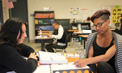 Carmen Quinonez, a teacher at a dropout program in Riverside County, Calif. called Come Back Kids, guides Quincey Bennett, 18, through an algebra problem. (Photo: Brenda Iasevoli)