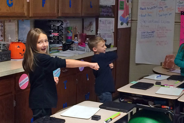 Third-grade students Lindsey and Zack in Ashley Cummins' math class punch and sing as they learn number sequences. (Photo: Meredith Kolodner)