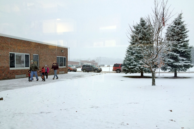 Lockwood elementary school families trudge to school the day before a massive storms buries upstate New York. (Photo: Meredith Kolodner)