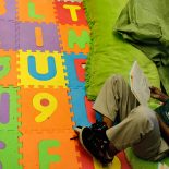 4th grader Noah Nafziger finds a quiet place to read during breakout groups in Lora Johnson's class at George Cox Elementary School in Gretna, La. Thursday, October 18, 2012. In 2010 the Louisiana Legislature passed Teacher Evaluation Reform. Now it's rolling out across Louisiana with local schools grappling with how to carry out the intense new requirements. The program, called Compass, consists of a two part annual evaluation, 50% based on observation by the principal and 50% on student performance. A designation of ineffective lands a teacher in a rehabilitation program. If improvements don't follow, teachers can be dismissed. (Photo by Ted Jackson, Nola.com / The Times-Picayune)