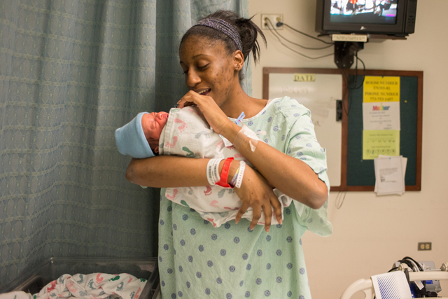 After a presentation from the Thirty Million Words Project at her hospital bedside, Bionka Burkhalter talks to her new baby, Josiah. (Photo: Julienne Schaer)