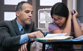 Alex Magaña with a student at Grant Beacon Middle School (Photo: Denver Public Schools)