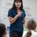 "School teacher Lynn Bryan teaches language arts at Ponce de Leon Middle School. When Miami-Dade public schools rolled out their performance pay plan to fanfare and cheering last year, it was the first district in Florida to get a head start on what will become a mandated policy in 2014 and felt like it took on frontrunner status in the nation. ""We're on the cutting edge for a large urban district,"" said Enid Weisman. Spurred on largely by competition for federal grants, the vast majority of states are in the midst developing performance pay models. Miami's system is a classic one as far as implementation goes with bonuses rewarded based on student performance on tests; its the kind that research has found doesn't make a significant change in student performance. So just where exactly does Miami rank among its national peers? With a sensitivity paid to getting teacher feedback and taking a multi-year approach to changing the culture, it holds more promise than failed ones in places like New York. But by sticking to test scores as the only variable, Miami is a step behind the multi-layered approaches in places like Denver and Austin."