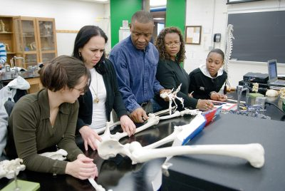 Students at Bronx Community College examine a human skeleton. (Photo by Ryan Brenzier)