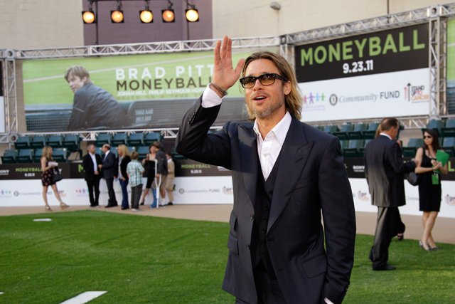 "Brad Pitt waves as he arrives at the Paramount Theatre of the Arts for the premiere screening of the movie ""Moneyball"" Monday, Sept. 19, 2011, in Oakland, Calif. (AP Photo/Ben Margot)"