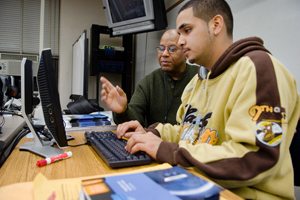 A student receives help at Bronx Community College