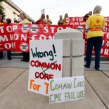 "People protesting the Common Core education standards demonstrate near the hotel where the meeting of Tennessee's Education Summit is taking place on Thursday, Sept. 18, 2014, in Nashville, Tenn. Thursday's event titled ""Progress of the Past, Present and Future"" will involve elected officials and representatives from 24 organizations focusing on K-12 and higher education. (AP Photo/Mark Humphrey)"