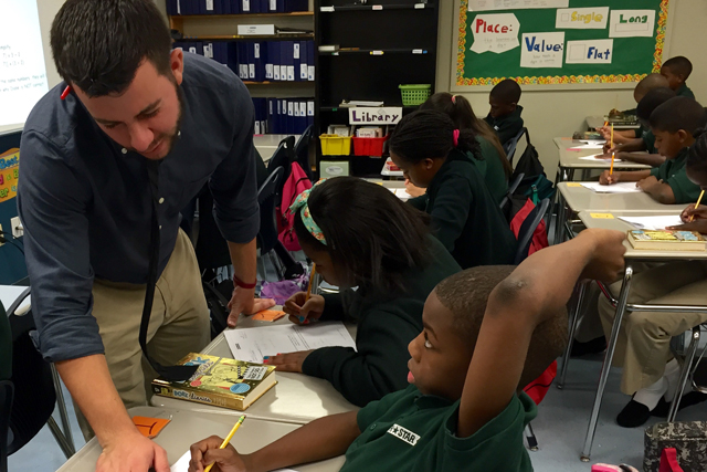 James Cavanagh, 22, helps one of his fifth-grade math students at North Star Academy's Downtown Middle School, a high-performing charter school in Newark. (Photo: Sara Neufeld)