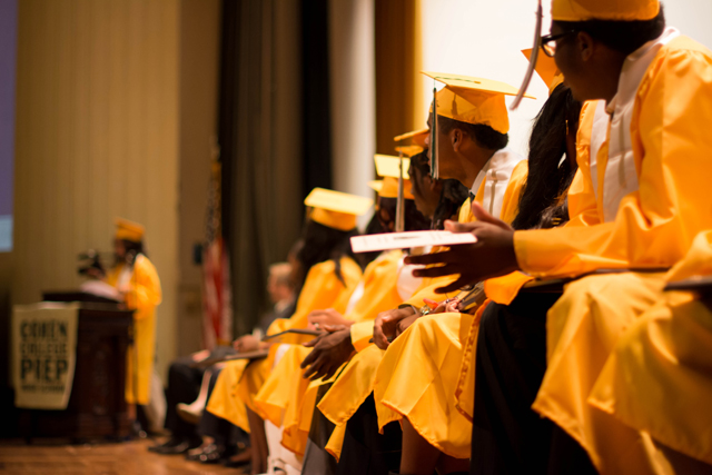Cohen College Prep's graduating seniors listen to a classmate speak during last spring's graduation ceremony — the first for the charter network. (Photo courtesy of New Orleans College Prep)