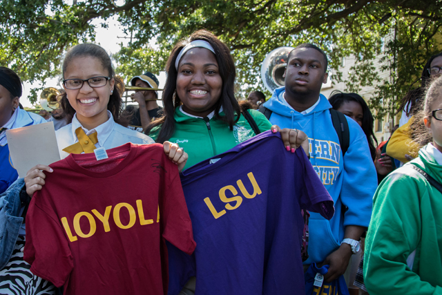 Students from Cohen College Prep hold up college sweatshirts. (Photo courtesy of New Orleans College Prep)