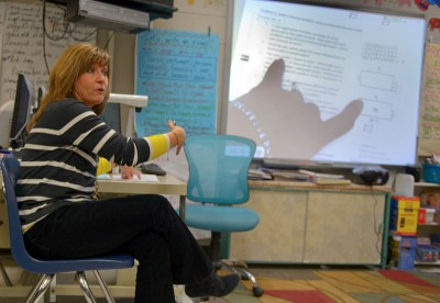 Belle Chasse Primary School fourth grade teacher Vickie Nagin reviews Common Core-aligned math problem with parents at the school. Matthew Hinton/The New Orleans Advocate