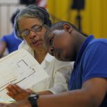 D'Andre's grandmother, Jean, reviewing a school map as he pointed out his new classrooms for seventh grade, is a constant presence at Quitman events. (Amanda Brown / NJ Spotlight)