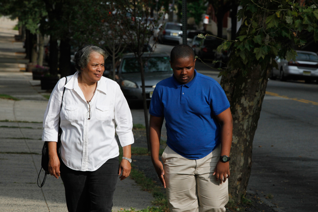 Jean, 68, walks her grandson, D'Andre, up the hill to school every day. (Amanda Brown / NJ Spotlight)