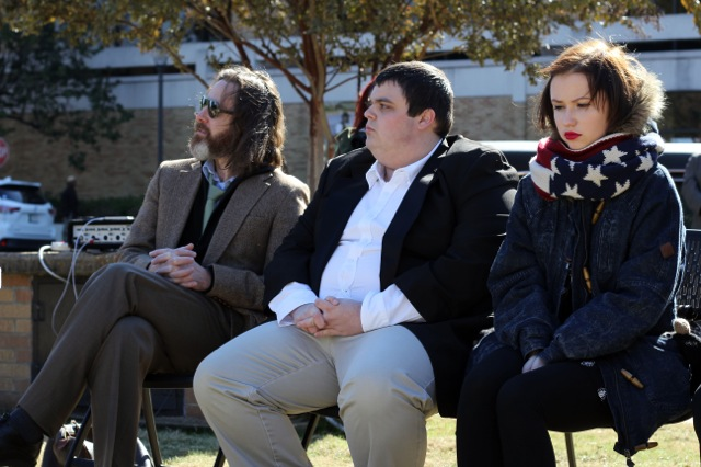Michael Ewing, Conor Bell, and Darya Hushtyn listen to speakers at a mock funeral to protest the elimination of several academic programs at Delta State University in Cleveland, Mississippi. (Photo: Jackie Mader/The Hechinger Report)