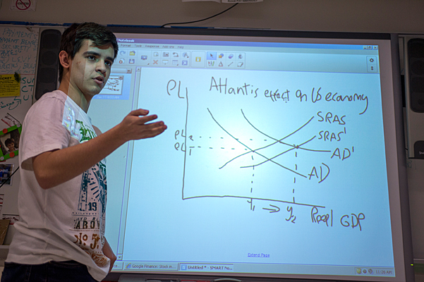 New Rochelle High School senior Esteban Acevedo, seen here plotting graphs in economics class in January 2014. (Photo: Ann Hermes/The Christian Science) No reproduction.