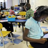 Sunset Park Elementary School third grader Anaya Hardy, 9, uses an iPad during digital morning math at Sunset Park Elementary School in Wilmington, N.C., Thursday, Oct. 30, 2014. (AP Photo/The Star-News, Mike Spencer)