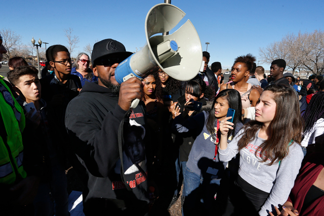 High school students and supporters participate in a protest against the Ferguson, Mo., grand jury decision, in front of City Hall, in Aurora, Colo., Friday, Dec. 5, 2014. Students from several Aurora high schools left school Friday in protest. (AP Photo/Brennan Linsley)