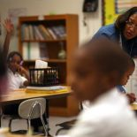 Second-grade teacher Eileen Seawood supervises a writing assignment at George Washington Carver Academy last week. (Photo by By Andre J. Jackson, Detroit Free Press)