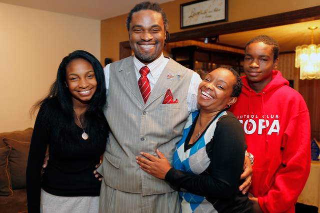 Erskine Glover with daughter Akilah (left), wife Yolanda and son Khamisi at the family's North Brunswick home. (Amanda Brown / NJ Spotlight)