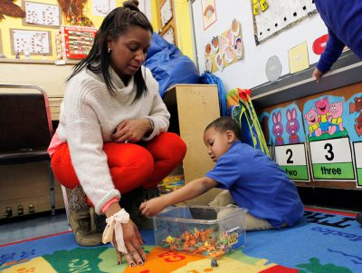 Celita Green plays with Zakhai Mason, a student in her pre-kindergarten autistic class. Zakhai's mother is excited about his progress at Quitman. (Photo by Amanda Eagen Brown)