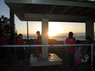 Teachers at Ka'a'awa Elementary School on Oahu prepare for an early morning sign-waving sponsored by the HSTA. (Photo by Sarah Butrymowicz)