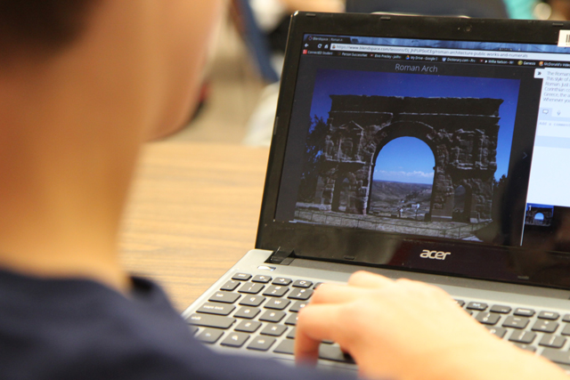 A student in Jennifer Harmsen's seventh-grade social studies classroom at Hillsborough Middle School watches a video on his Chromebook about life in ancient Rome. (Photo: Meghan E. Murphy)