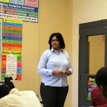 Shirlinda Robinson, an English teacher at Oakley Youth Development Center, walks through new standards with her second period class. (Photo by Jackie Mader)