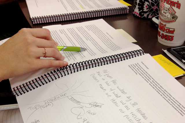 Lori Smith, a teacher leaders in the Kingsport City Schools district, takes notes in a Common Core workbook at a Common Core training session in Kingsport, Tenn.