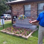 Leroy Clemons, president of the Neshoba County, Mississippi branch of the NAACP, gives a tour of Freedom Summer sites, including this memorial to slain civil rights workers Andrew Goodman, James Chaney and Michael Schwerner.  (Photo: Liz Willen)